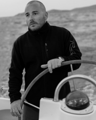 SUP and skipper Athanasios Prekas Greek Water Yachts sailing charters